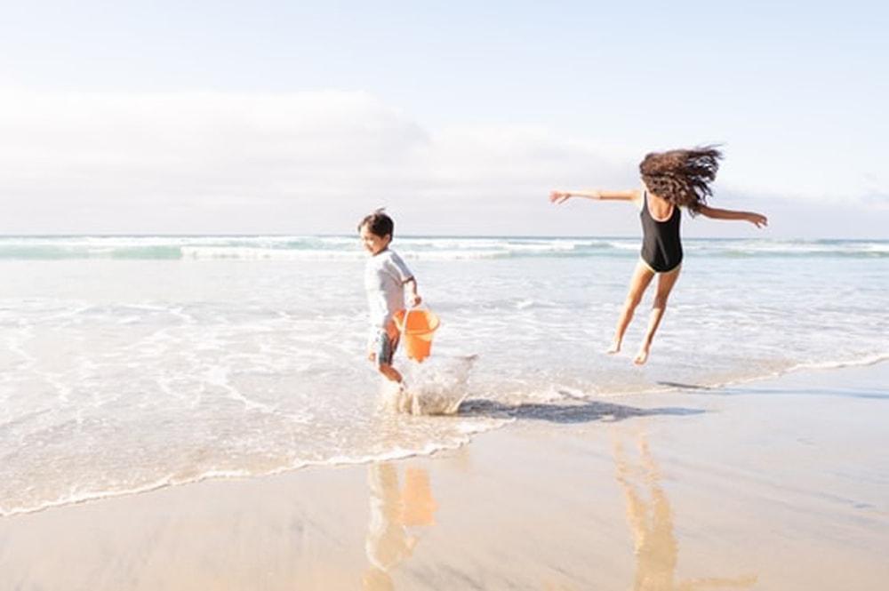 kids on beach wearing sunscreen