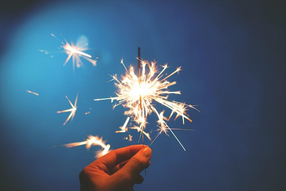 close up hand holding sparkler fire safety